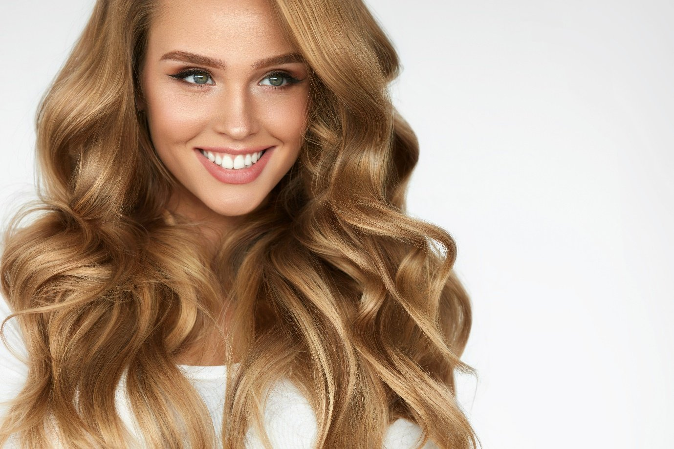 A picture containing clothing, person, smiling, hairpiece  Description automatically generated